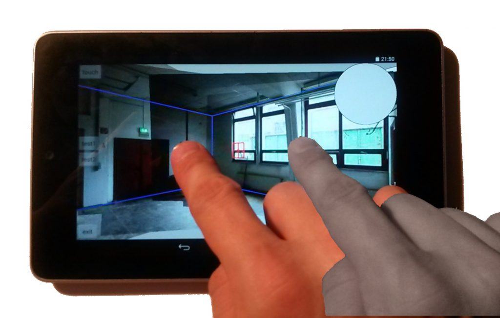 Tablet covered by fingers while interacting